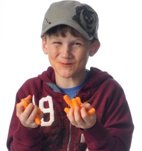 Picture of Stevie, eating handfuls of cheese puffs and getting cheese all over himself.